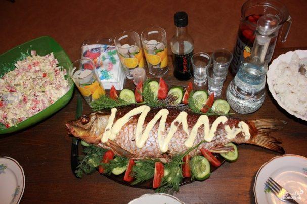 Рыба, запеченная с квашеной капустой