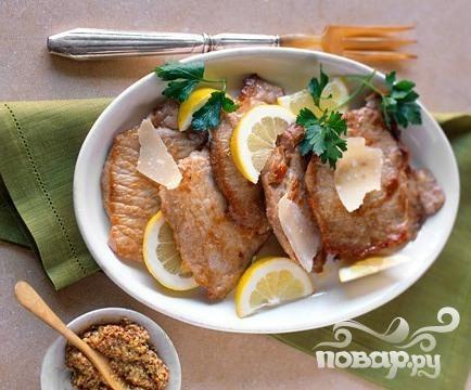 Свиные отбивные с лимоном и сыром