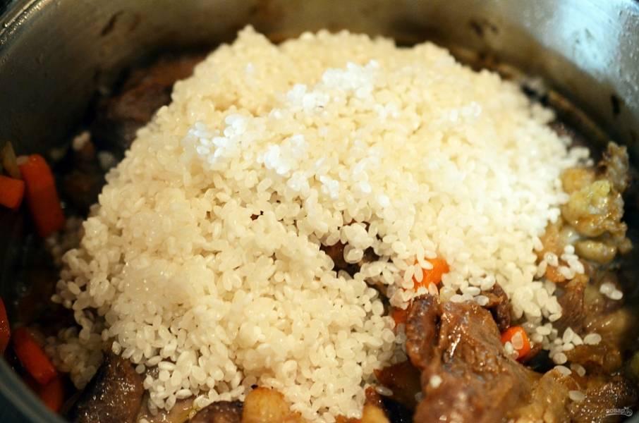 11. Добавляем промытый рис.