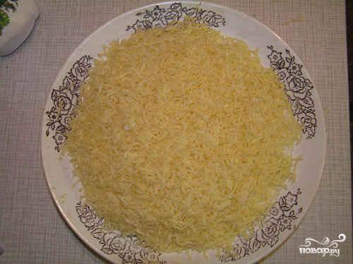 4. Четвертый слой - тертый на мелкой терке сыр.