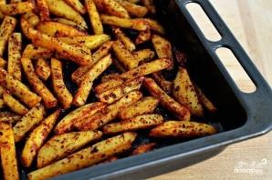Жареный в духовке картофель со специями - фото шаг 7