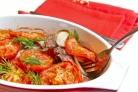Мясо в духовке с помидорами