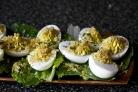 Салат с фаршированными яйцами