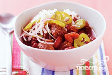 Рецепт Жаркое из говядины, итальянских колбасок и помидоров