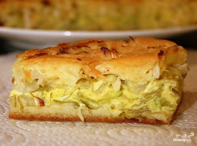Пирог из слоеного теста с капустой и яйцом с фото рецепт пошагово с фото