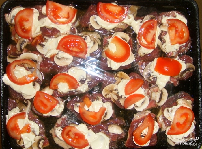 Фаршированные кружочками кабачки в духовке