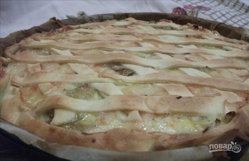 Выпекайте капустник-пирог в предварительно разогретой до 180 градусов духовке в течение примерно 25-30 минут.