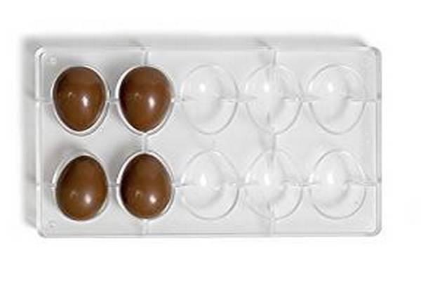2.А вот формочка для маленьких шоколадных яиц (по размеру чуть больше перепелиных). Такие шоколадные яйца лучше заполнять разнообразной начинкой: например, шоколадной или кремовой, на ваш выбор. Такие маленькие яйца можно покрывать разноцветной глазурью, украшая таким образом десерт, будет очень красиво.