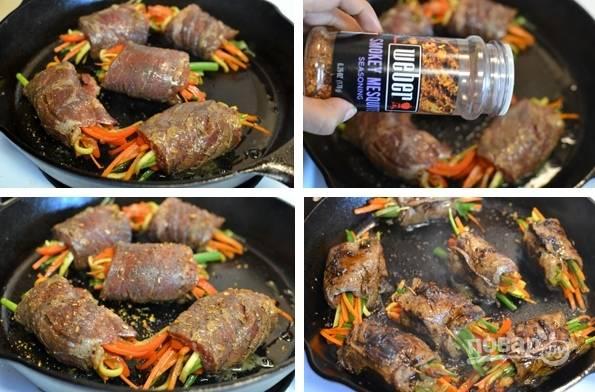 5. Заверните овощи в мясные роллы. Поместите их в сковороду, залейте бульоном, приправьте сахаром, солью и перцем по вкусу. Тушите роллы до полной готовности мяса. Приятного аппетита!