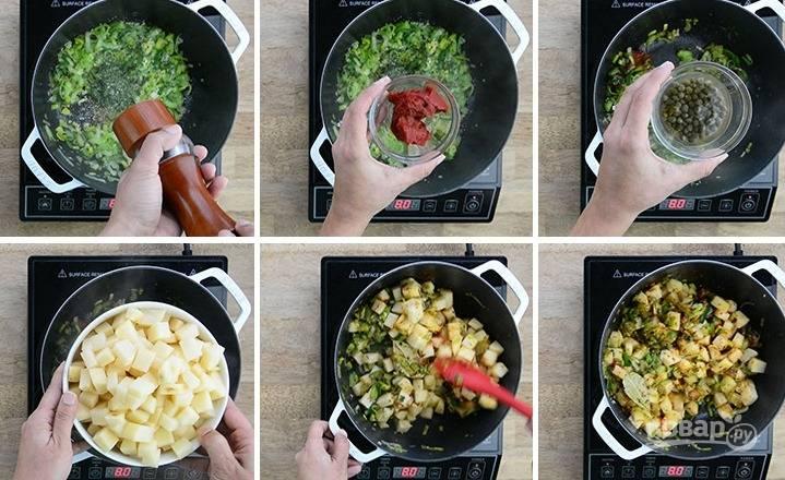 1. Растопите масло в кастрюле на среднем огне. Добавьте нарезанные лук-порей,  измельченный чеснок и сельдерей, обжарьте их в течение 3-4 минут. Добавьте петрушку, укроп, лавровый лист, соль, перец, томатную пасту и кубиками нарезанный картофель.