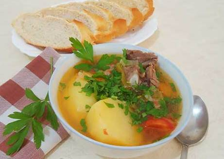 Подаем шурпу в глубоких суповых тарелках, посыпав зеленью, с лепешками или хлебом.