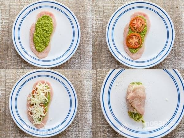 3. Каждый кусочек мяса смажьте соусом, сверху выложите нарезанный кольцами помидор, посыпьте тертым сыром. Заверните в рулетик, швы закрепите зубочисткой.