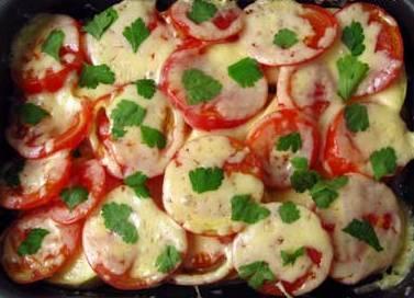 Натереть сыр, посыпать сверху на помидоры и отправить опять в духовку на 10 минут, пока сыр не расплавится. Готово!
