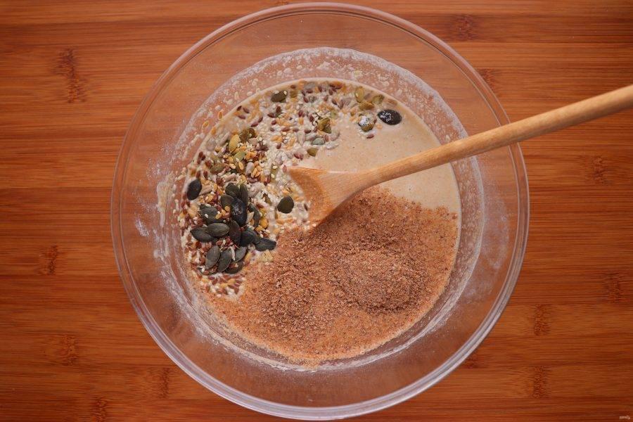 Затем добавьте семечки, отруби и соль.