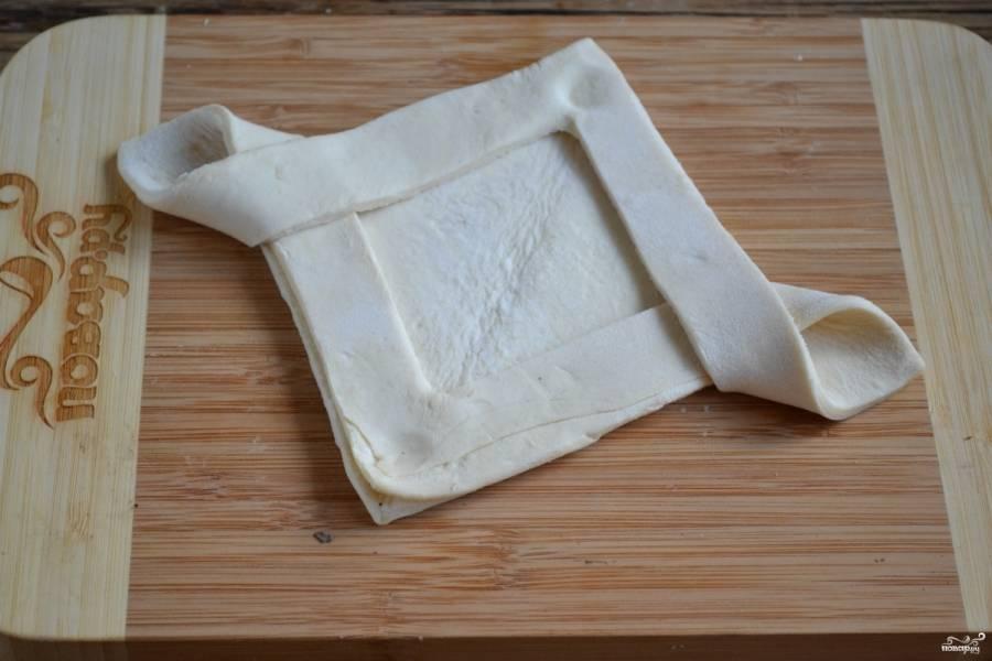 Заверните тесто, как показано на фото.