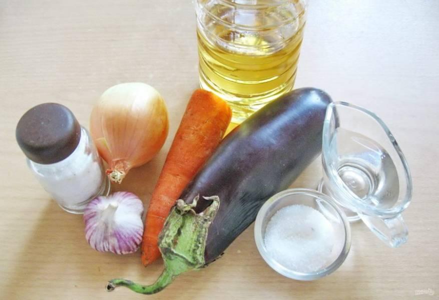 Для приготовления этого салата потребуются: баклажаны, морковь, лук репчатый, чеснок, вода, подсолнечное масло, соль, сахар, уксус.