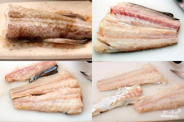 Начинаем с рыбы. Как показано на фото, отрезаем хвост и плавники рыбы, отделяем филейную часть от кожи и костей.