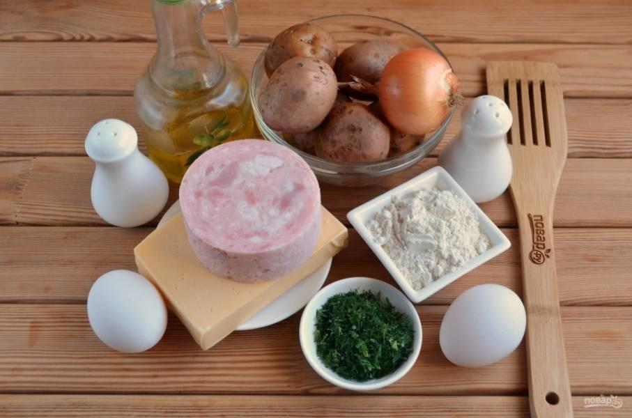 Подготовьте продукты, очистите картофель, лук, порежьте мелко укроп.
