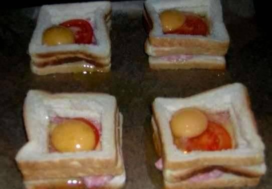 Таким образом, у нас получается что-то наподобие колодца с углублением, в него-то мы и разбиваем яйца, по одному на каждый бутерброд, яйцо нужно посолить и посыпать специями.