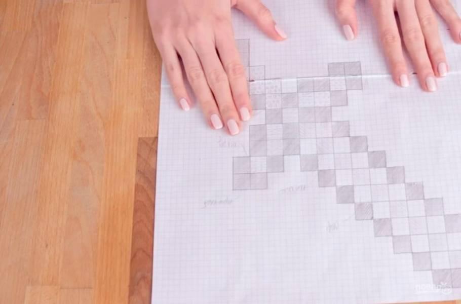 1. Для начала сделайте разметку будущего меча на бумаге, чтобы кубики получились ровными.