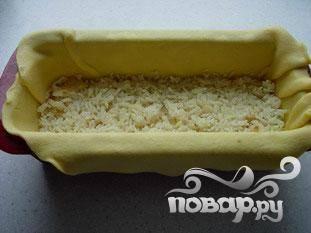 Накрыть слоем риса.