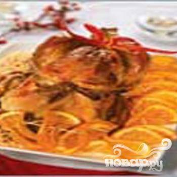 6.Нарезаем кружочками апельсины,  разводим апельсиновым соком желатин и смазываем кружочки. Подаем к индейке.