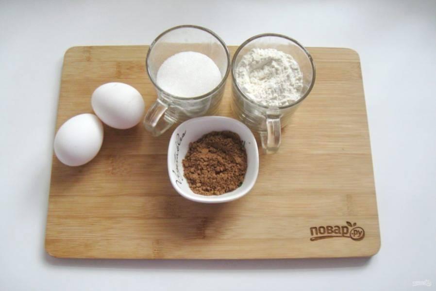 Подготовьте ингредиенты для приготовления шоколадного бисквита.