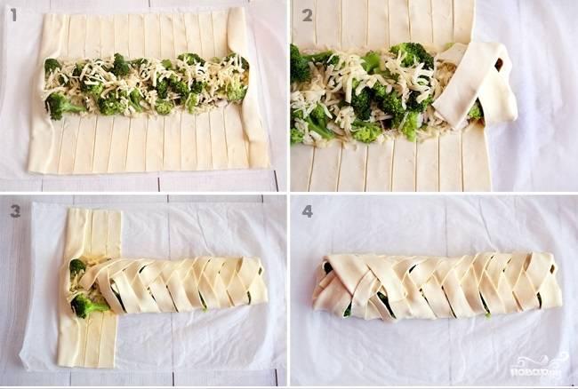 Шаг 5. Разогрейте духовку до 200 градусов. Распределите курицу и брокколи по центру теста. По бокам теста сделайте полосы шириной 2 см. (как на фото). Заворачивайте полоски таким образом, чтобы получилась косичка. Сверху посыпьте кунжутом. Запекайте в духовке 15-20 минут до золотистой корочки.