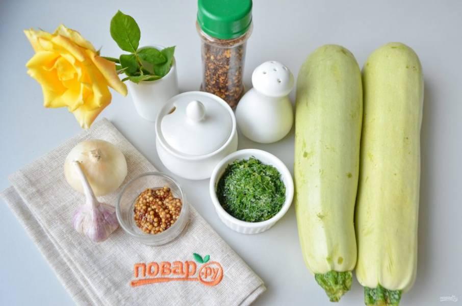 Подготовьте необходимые продукты, кабачки вымойте, лук и чеснок очистите и сполосните под водой. Зелень мелко порубите. Приступим!