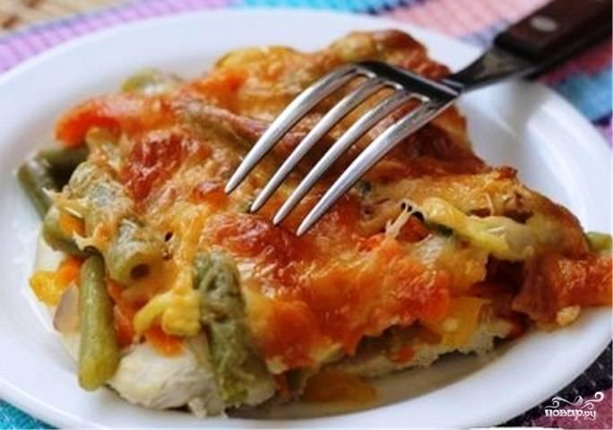 Курица под овощами в духовке
