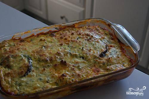 5. Посыпать оставшимся сыром Пармезан и поставить в духовку на 20 минут. Выпекать до верхушки коричневого цвета.