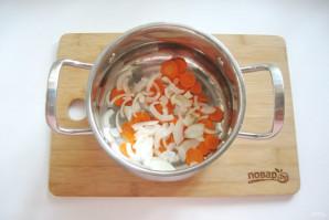 Хек тушеный с луком и морковью - фото шаг 2