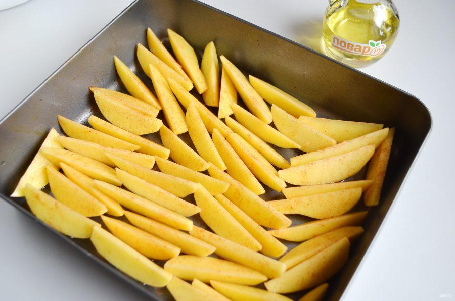 Картофельные дольки перед запеканием