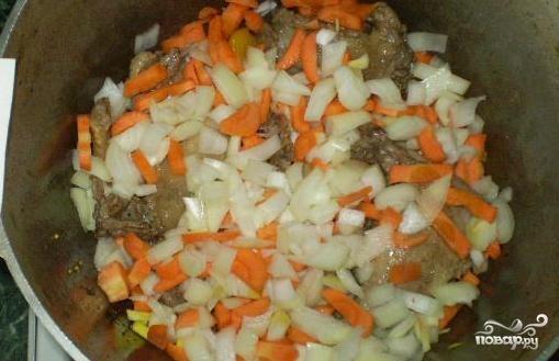 Утка, тушенная с овощами
