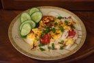 Отбивные в духовке с помидорами и сыром